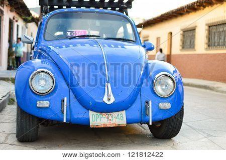 Old Blue Car Parked In The Streets Of San Cristobal De Las Casas, Chiapas, Mexico