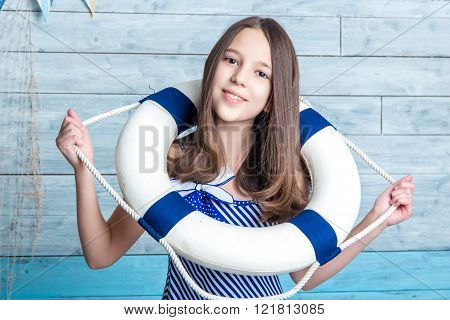 young girl in a striped dress dressed lifeline looking at the camera