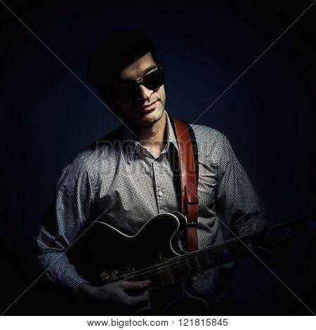 Jazz Musician Playing A Guitar