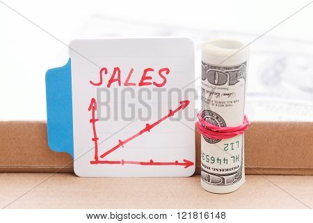 Photo of draw a graph and dollar bill