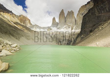 torres del paine lake in patagonia with rock walls