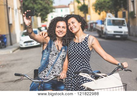 Female Friends Taking A Selfie With Their Bicycles.