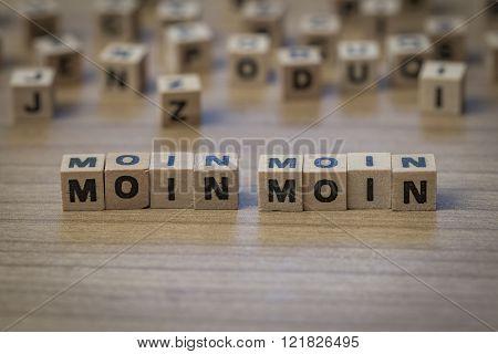Moin Moin Written In Wooden Cubes