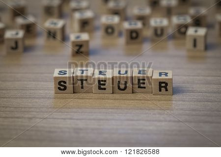 Steuer Written In Wooden Cubes
