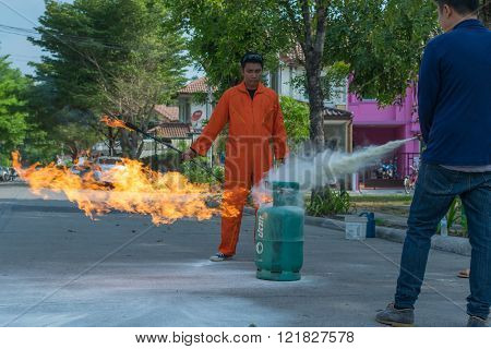 Bangkok, Thailand - January 31, 2016 : Many people preparedness for fire drill and training to use a fire safety tank in village at Bangkok Thailand.