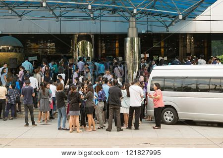 Bangkok Thailand - November 20 2015 : Many working people preparedness for fire drill or other disaster at office in Bangkok Thailand