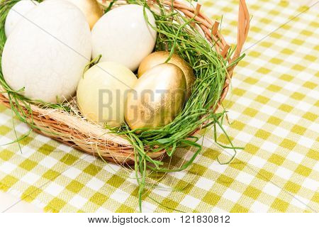 Basket with golden easter eggs