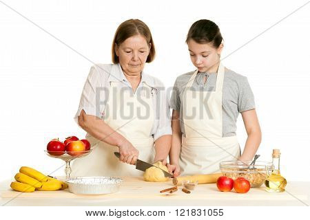 The Grandmother And The Granddaughter Cut Dough