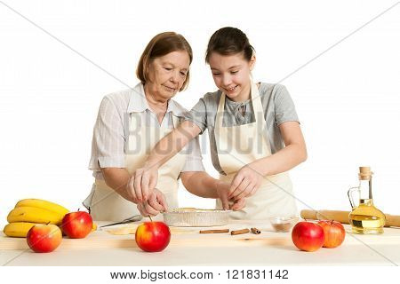 The Grandmother And The Granddaughter Stack Dough Strips