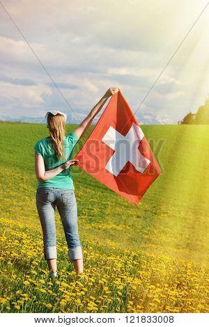 Girl holding Swiss flag. Emmental, Switzerland