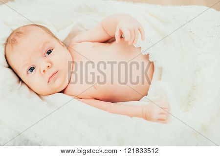 Little Baby (child,kid ) Wrapped In A White Knitted Blanket. Newborn