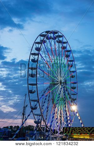 A Ferris Wheel On A Market In The Evening