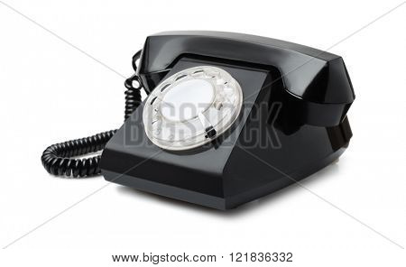 Old black rotary phone isolated on white