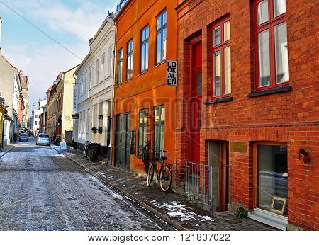 MALMO SWEDEN - MARCH 14: View of the street in historical centre of Malmo Sweden on March 14 2013. Malmo is the capital and most populous city in Skane County Sweden.