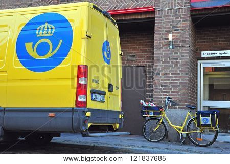 MALMO SWEDEN - MARCH 14: Car and bike with logo of Post Office of Sweden in Malmo on March 14 2013. Malmo is the capital and most populous city in Skane County Sweden.