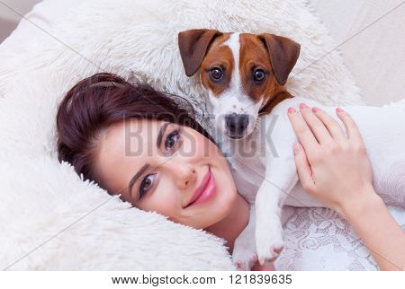 Portrait Of A Young Woman With Dog