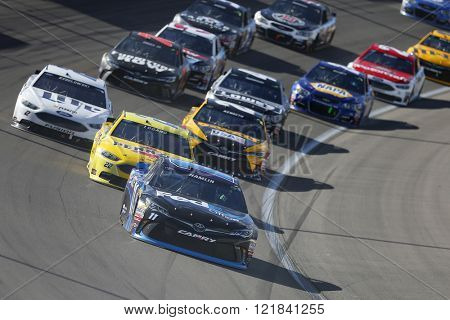 Las Vegas, NV - Mar 06, 2016: Denny Hamlin (11) leads the pack through the turn during  the Kobalt 400 at the Las Vegas Motor Speedway in Las Vegas, NV.