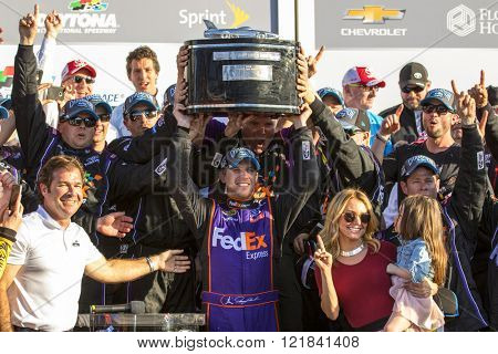 Daytona Beach, FL - Feb 21, 2016: Denny Hamlin (11) celebrates winning the Daytona 500 at the Daytona International Speedway in Daytona Beach, FL.
