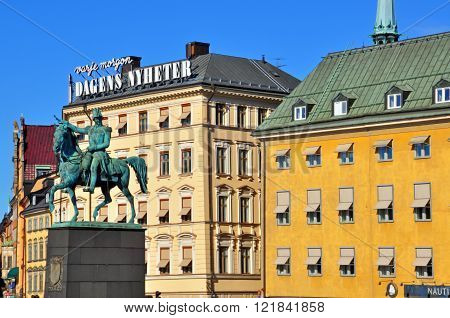 STOCKHOLM SWEDEN - MARCH 16: View of colorful houses and monument on the square of Stockholm on March 16 2013. Stockholm is the most populous city in Sweden and on the Scandinavian peninsula.