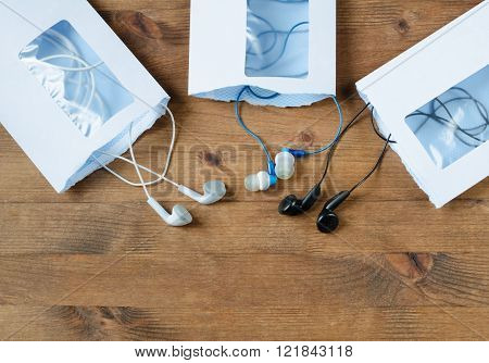 opened envelopes and multicolored Audio headphones