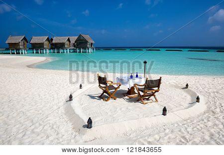 Romantic lunch setup on Maldivian beach