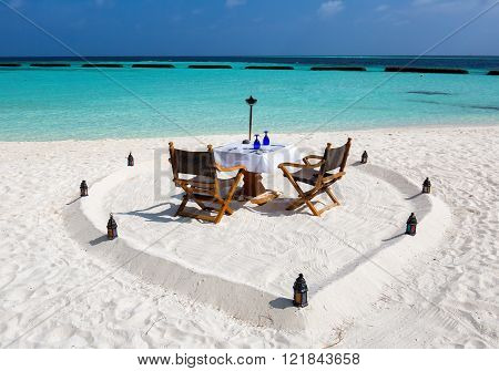 Romantic dinner setup on Maldivian beach