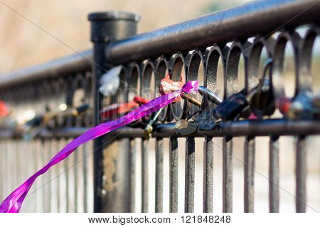 Several Castles And A Scarlet Ribbon On The Fence