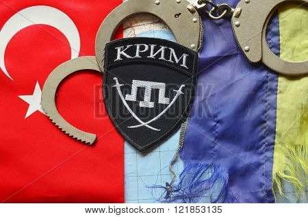 Kiev,Ukraine.FEB 20 Chevron of Islamic extremist formation Crimea.Background map of Kherson Caliphate & Turkey flag on February 20,2016 in Kiev, Ukraine