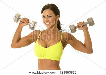 a woman with a smile on her face working out with weights.