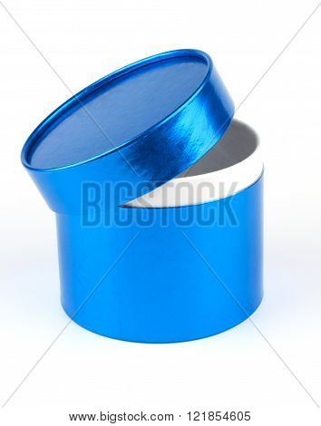 Round blue gift box with lid ajar