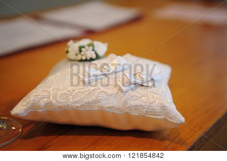 beautiful wedding rings on ring barer pillow