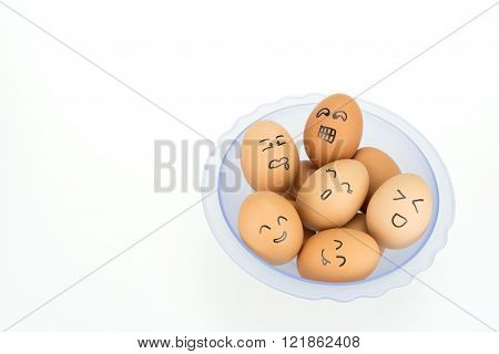 Eggs With Smiling Happy Faces On Plastic Bowl, Isolated On White Background