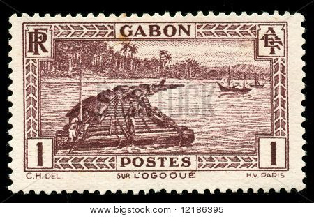 vintage African stamp from Gabon depicting native worker on logging raft on the Ogooue river poster