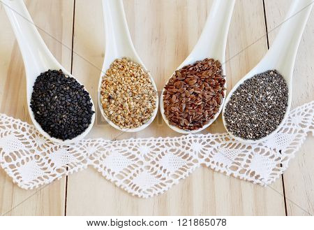 Useful seed. Proper nutrition with the addition of seeds. Chia seeds. Flax seeds. White sesame seeds. Sesame seeds black.