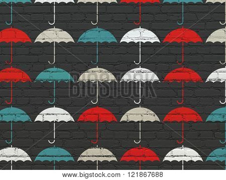 Protection concept: Umbrella icons on wall background