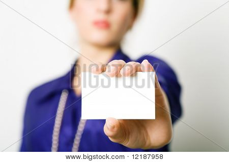 Businesswoman presenting her (blank) business card (shallow depth of field)
