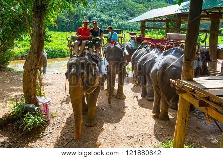 KHAO SOK, THAILAND - NOV 13, 2012: Unidentified people on the elephant trekking in Khao Sok National Park. This is one of the biggest tourist attraction in Phang Nga province, Thailand.