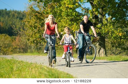 A family with children having a weekend excursion on their bikes
