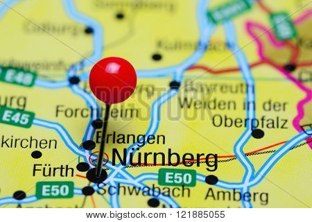Photo of pinned Nurnberg on a map of Germany. May be used as illustration for traveling theme.