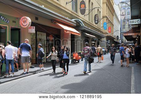 MELBOURNE AUSTRALIA - MARCH 13, 2016: Unidentified people walk Melbourne café street in downtown Melbourne.