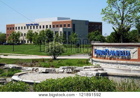 PLAINFIELD, ILLINOIS / UNITED STATES - MAY 22, 2015: An ornamental retention pond decorates the entrance to the Edward Plainfield Emergency Department, Outpatient Center, and Medical Office Building.