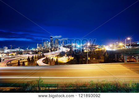 traffic on city road through modern buildings in seattle