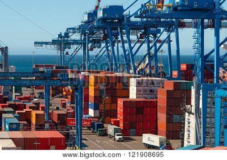 Valparaiso, Chile - December 3, 2012: Shipping containers in the historic port of Valparaiso in Chile. Valparaiso is a major port serving the capital city of Santiago.