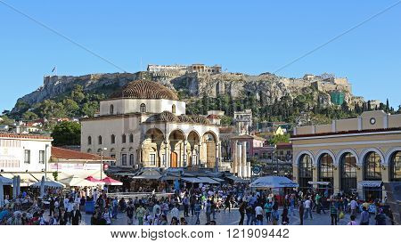 ATHENS GREECE - MAY 04: Crowd of Tourists at Monastiraki Square in Athens on MAY 04 2015. Popular Shopping District With Tsisdarakis Mosque in Old Town of Athens Greece.