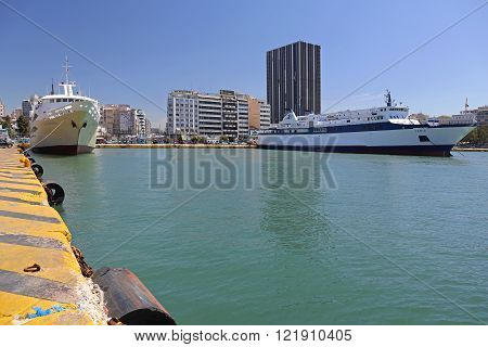 PIRAEUS GREECE - MAY 04: Commercial Port in Piraeus on MAY 04 2015. Docks with Ships and Ferryboats in Biggest Greek Seaport in Piraeus Greece.