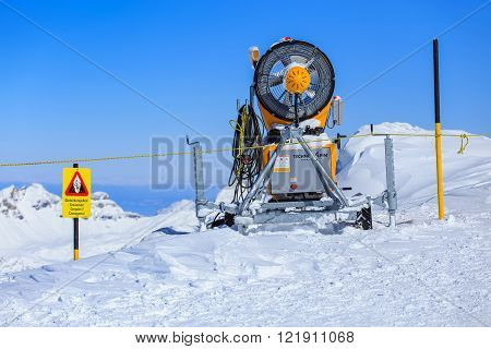 Mt. Titlis Switzerland - 9 March 2016: snow cannon on the top of the mountain. Titlis is a mountain of the Uri Alps located on the border between the cantons of Obwalden and Bern.