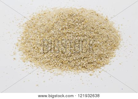 Close up shot of raw oat bran loose isolated on white