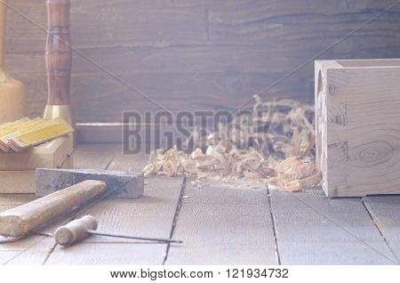 Different Instruments And Wooden Chips On Floor