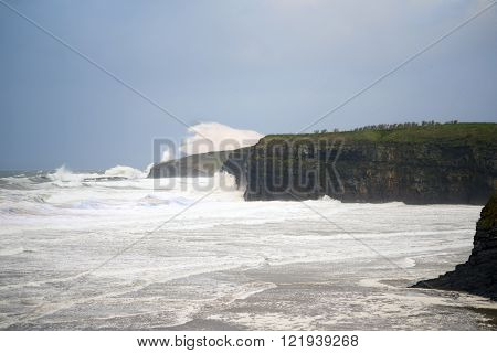 storm waves and cliffs on the wild atlantic way in Ballybunion county Kerry Ireland
