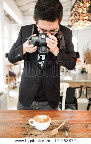 Asian hipster busines man take coffee photo
